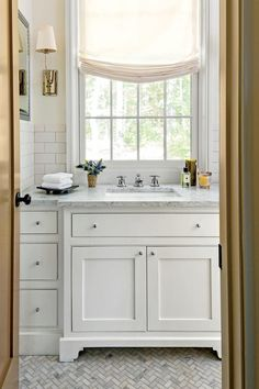 The herringbone pattern adds color and texture to this small bathroom