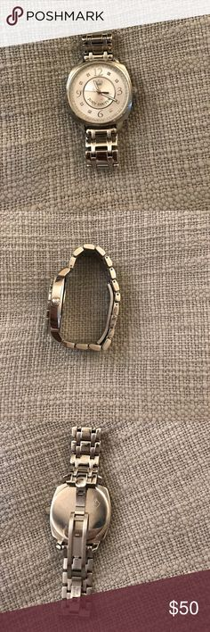 Juicy couture watch Stainless steel juicy couture watch with crystals  surrounding the outer face of the watch. In great condition! Just needs a new battery. Juicy Couture Accessories Watches
