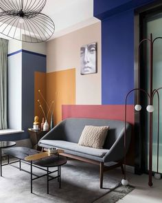 Colour Blocking Interiors: Feature Wall Modern Living Room - - Looking at the interior design trend of colour blocking. Here are some modern, different and inspiring ways of using colour blocking throughout your home.