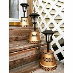 Looks great and is also practical to light up the stairs. Upturned, painted terracotta pots and solar lights.