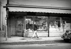 """February 1942. Detroit, Michigan. """"Sign in a grocery window in the Negro district: 'chitlins and hog maws'."""" Not to mention Taystee Bread. Medium-format nitrate negative by Arthur Siegel for the Office of War Information"""
