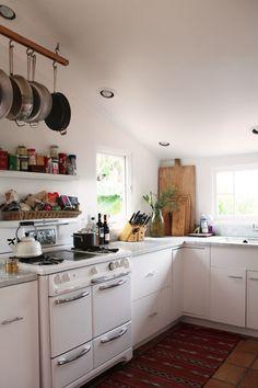 Light and lovely kitchen.