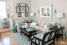 Calming Neutral & Aqua Accented Coastal Living Room by Breezy Design at foxhollowcottage.com #coastallivingroomsfireplace