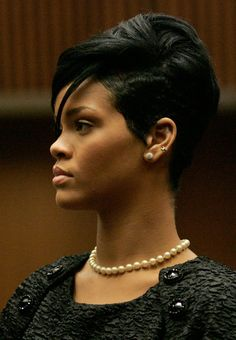 Elegant and sophisticated...Rihanna Rocks in classic studs and a strand of pearls.