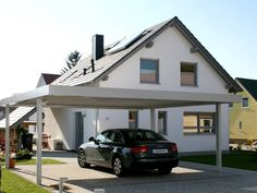 carport mit seitlichem anbau als berdachung f r den eingang carport carport einhausungen. Black Bedroom Furniture Sets. Home Design Ideas