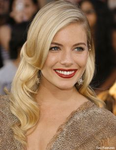 Sienna Miller- her natural face, bold lips, and relaxed curls create such a glam look.