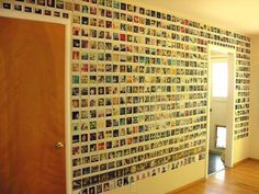 Polaroid photo collage over an entire wall in a room.