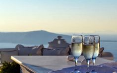 Wedding in Santorini ~ Weddings in Greece - Lots of champagne during ceremony