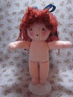 knitted waldorf doll tutorial (picture) blog is http://www.byhookbyhand.blogspot.com/ scroll down and on the left hand side there is a link to download the pattern and outfits. lots of different patterns for knit and crochet dolls as well