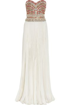 MARCHESA White Embellished Strapless Silk Gown With an intricately beaded bodice and flowing off-white silk, Marchesas exquisite gown makes a breathtaking choice for your next special occasion.Marchesa gown: off-white silk, multicolored embellished detail, sweetheart neckline, pleated detail throughout, fully lined. Zip and clasp fastening at back. 100% silk. Dry clean.; $3975