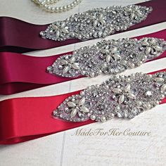 Exclusive: Wedding Sash Belt, Pearl Crystal Sash, Rhinestone belt/sash, Bridal Belt, Red Wedding Sash, Burgundy Wedding Sash  This listing is for one bridal belt/sash. Please choose your colour from the drop down menu. This bridal sash/belt will make a beautiful addition to your wedding dress. Simply choose your choice of color and let us put it together. The sash is embellished with pearls and high quality glass crystals. The double faced satin sash ribbon is approximately 4 yards long…
