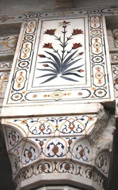 Agra, Uttar Pradesh, India - The interior chamber of the Taj Mahal steps far beyond traditional decorative elements. Here, the inlay work is not pietra dura, but a lapidary of precious and semiprecious gemstones.