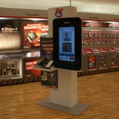"""Phones4u Demo hero zone  This unit designed produced and installed by H Squared is the """"Ultimate in retail digital media""""  The unit has the following tech :  1) 37"""" touch screen which can rotate portrait and landscape positions 2) reactive product zones so content can change when a product is played with by customer  3) remote media - content can be uploaded and changed daily from our studio 4) web cams - so shoppers can photograph themselves and upload to Facebook  5) gesture control can be…"""