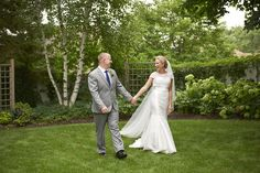 Bride and Groom take a walk in the garden at Bloomington Sheraton Wedding