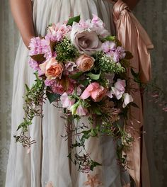 Bride bouquet Flower colors should be more white and cream with accent colors throughout. Jasmine vines more down the midline and a few more leaves sprouting from main bundle of flowers.
