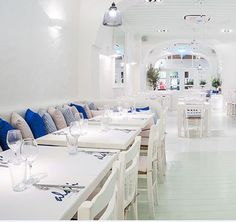Restaurant ALATI in Singapore - Stepping into Alati is like stepping out of Singapore and into a Greek taverna gripping the flank of Santorini's volcano, all blindingly white-washed walls, cerulean blue accents – and sunkissed food.