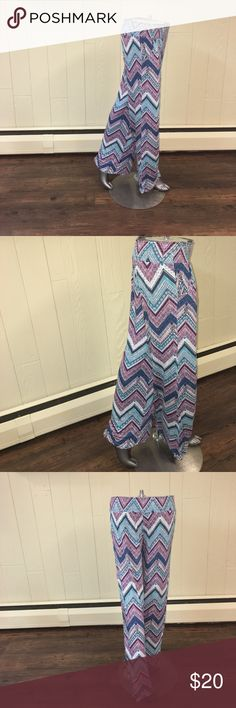 Multi-Color Palazzo Pants Perfect summer palazzo pants! Super comfy and light! Fun colors! So great to throw on with flip flops! Elastic waist and has pockets! Pants
