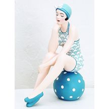 Bathing Beauty Beach Girl Figurine in Coastal Living Blue... Add a touch of the coast to your home decor with this lovely Bathing Beauty all dresssed in a beautiful sea blue swimsuit with matching cap and slippers. And don't forget the sea blue beach ball with white polka dots... how fun! If you love coastal home decor than this beach gal is for you. To see our entire Bathing Beauty Figurine Collection, visit InsideOutCatalog.