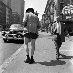 Street Photography    Vivian Maier Photographer / man looks in surprise the other man in shorts  #vivian #maier
