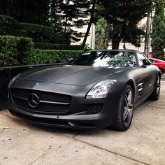 Mercedes Benz SLS AMG. This colour is absolutely gorgeous, suits the SLS's personality massively!