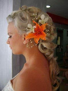 Not the actual hairstyle, or the baby breath, but the big orange and small white are really pretty