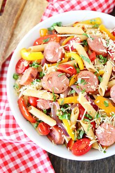 Spicy Sausage and Pepper Pasta Recipe on twopeasandtheirpod.com This delicious pasta dish only takes 30 minutes to make! #pasta