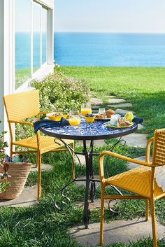 The global-meets-floral appeal of Pier 1's Chloris Blue Mosaic Bistro Table is undeniable and similar to what we've always known about denim—it goes with everything. Hand-forged and hand-painted, our metal table features a ceramic top and fits perfectly in a compact space, indoors or out.