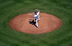 Kershaw pulled, still gets the win -  Los Angeles Dodgers starter Clayton Kershaw (22) delivers a pitch against the Arizona Diamondbacks at Dodger Stadium on Sept. 24 in Los Angeles. - © Kirby Lee/USA TODAY Sports