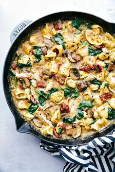 An easy and delicious dinner recipe -- creamy sun-dried tomato, mushroom, spinach, and chicken tortellini prepared and cooked all in one skillet.