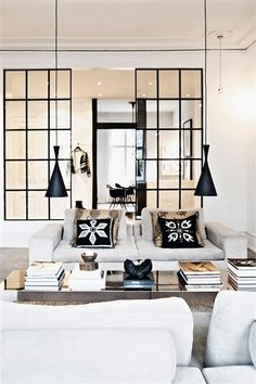 Like the pendant lights over the coffee table. They save space and do not obstruct the view.