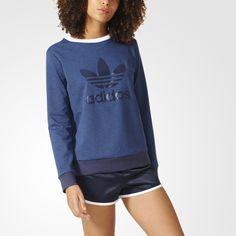 Com um toque da moda street de Nova York, esta blusa de moletom feminina une uma vertente urbana ao estilo adidas Originals representado pelo logo Trefoil grande e impresso em silicone no peito.