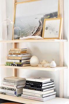 Leaning art on bookshelves