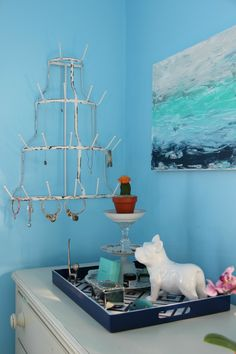 How cool - a bottle drying rack turned jewelry holder from HomeGoods eclecticallyvintage.com sponsored