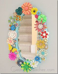 Vintage enamel flower pins on mirror - cute!