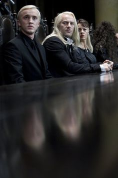 Lucius, Narcissa and Draco look scared at Voldemort's table in Malfoy Manor