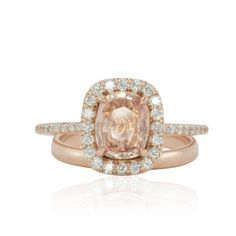 How pretty is this peach sapphire engagement ring with 14k rose gold!? In love with this engagement ring by @lauriesarah See more here: https://www.lauriesarahdesigns.com/product/peach-sapphire-engagement-ring-with-14k-rose-gold-with-plain-band/