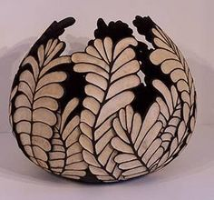 This amazing black and white bowl is carved from one thick gourd in an African fern leaf pattern.