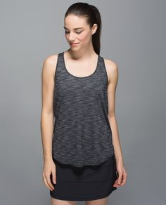 We designed this lightweight and loose-fitting tank to layer easily over any bra. The breathable,  anti-stink fabric helps to keep us cool in even the hottest of Hot yoga classes so we can go ahead and get sweaty.
