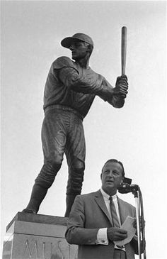Aug. 4, 1968, former St. Louis Cardinals baseball player Stan Musial stands near a statue of him at the plate, outside Busch Stadium.  Musial, one of baseball's greatest hitters and a Hall of Famer with the Cardinals for more than two decades, has died. He was 92. Stan the Man won seven National League batting titles, was a three-time MVP and helped the Cardinals capture three World Series championships in the 1940s