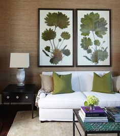 A pair of giant botanical prints brings a punch of green to the sitting room. - Traditional Home ®/ Photo: Colleen Duffley / Design: Erika Powell