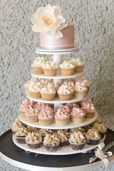 This is pretty - have the cute cakes ombré, but from white to darker grey on the bottom. Our cake on top. No flower tho