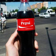 Coke bottle with Pepsi name label ~ Funny You Had One Job Fails