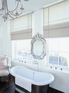 Symmetrical Bathroom With Roman Blinds And Venetian Mirror