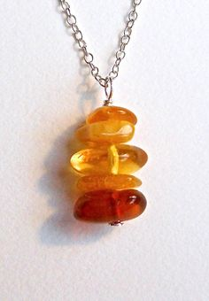 Amber Necklace Sterling Silver Amber Necklace. So simple, yet what a statement the gemstones make!