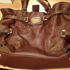Michael kors bag Re-poshing..i used it a few times but no longer needed..has a few signs of wear prior to be buying it..a few marks inside tht i cleaned hopefully came out..i will bundle this with the mk chocalte watch for $220.00 if wanted Michael Kors Bags Shoulder Bags