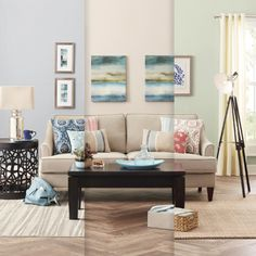 Lowe's Creative Ideas. Same couch and coffee table, different paint, side tables/lighting, pictures, rugs!!!