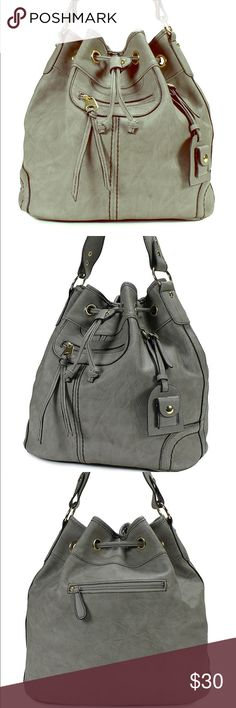 """Scarleton Grey Large Handstring Bag/Purse Great purse that you can wear anywhere! It has a timeless style with a quality finish. It is really spacious and big on the inside. Has interior and exterior compartments for your cell phone, wallet, or keys. Easy to carry two ways, top handle, or cross body shoulder straps. Adjustable. Synthetic vegan leather with fabric lining. Cross body strap is about 25"""" Scarleton Bags"""
