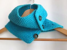 This ladies Aran wool cowl neck warmer is great for keeping that winter and Spring chill off. It's made in a lovely soft turquoise Aran wool wool) and fastens with 3 chocolate brown wooden buttons. It's hand knitted in a moss stitch pattern. Moss Stitch, Colour List, Neck Warmer, Fingerless Gloves, Lana, Hand Knitting, Stitch Patterns, Knit Crochet, Turquoise