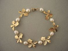 Items similar to Gold Flower and Pearl Bracelet, Bridesmaids Jewelry, Bridal Jew. - Items similar to Gold Flower and Pearl Bracelet, Bridesmaids Jewelry, Bridal Jewelry on Etsy – G - Bridal Bracelet, Pearl Bracelet, Pearl Jewelry, Pendant Jewelry, Wedding Jewelry, Antique Jewelry, Jewelry Bracelets, Gold Jewelry, Wire Necklace