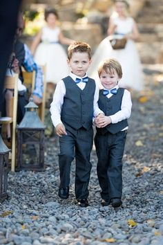 Adorable Ring Bearers with Blue Bow Ties | Photography: Sallee Photography. Read More:  http://www.insideweddings.com/weddings/rustic-chic-lakeside-wedding-with-geometric-details-in-california/843/